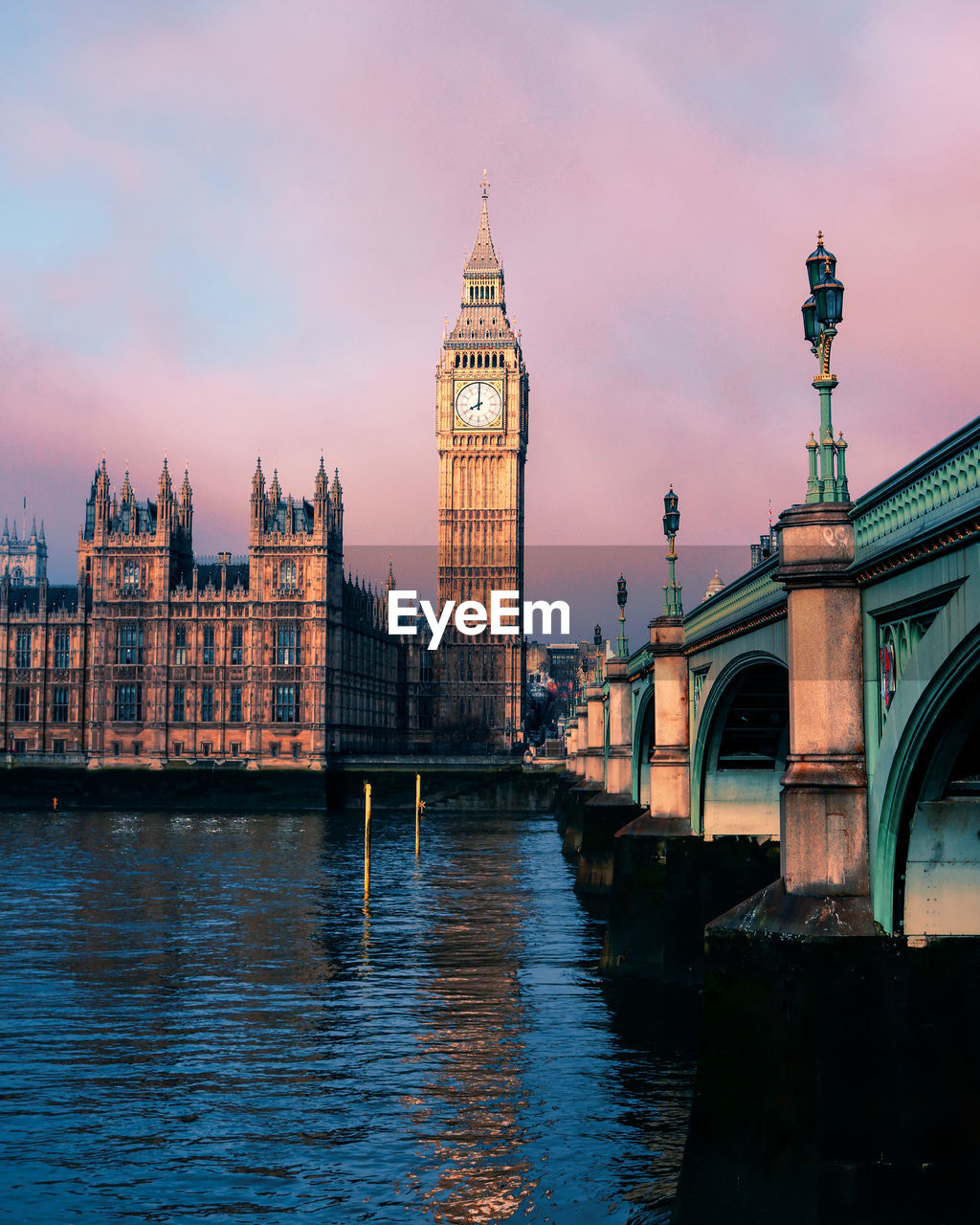 Westminster bridge over thames river against big ben