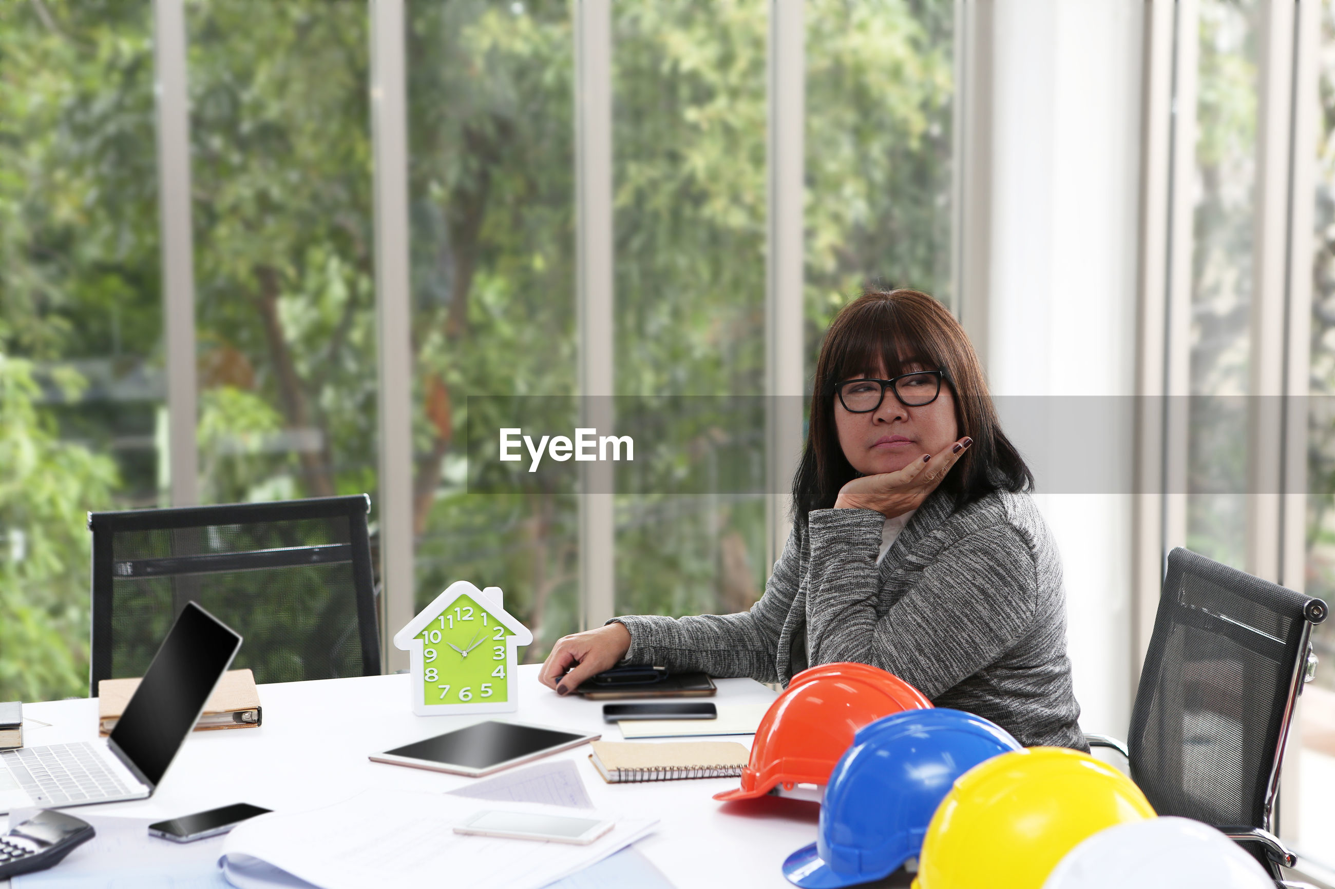 Businesswoman looking away while sitting in office