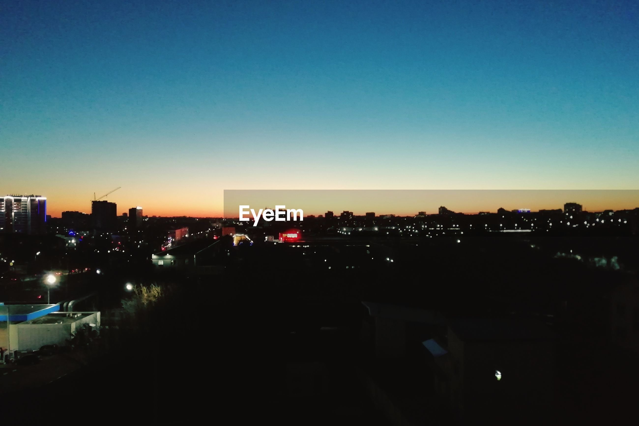 sky, building exterior, architecture, city, built structure, illuminated, copy space, no people, cityscape, sunset, nature, silhouette, clear sky, building, landscape, outdoors, high angle view, dark, night, residential district
