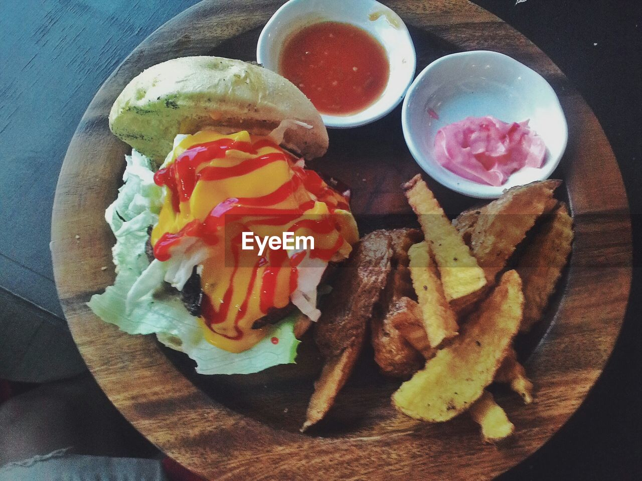 High angle view of burger with fried potato in plate