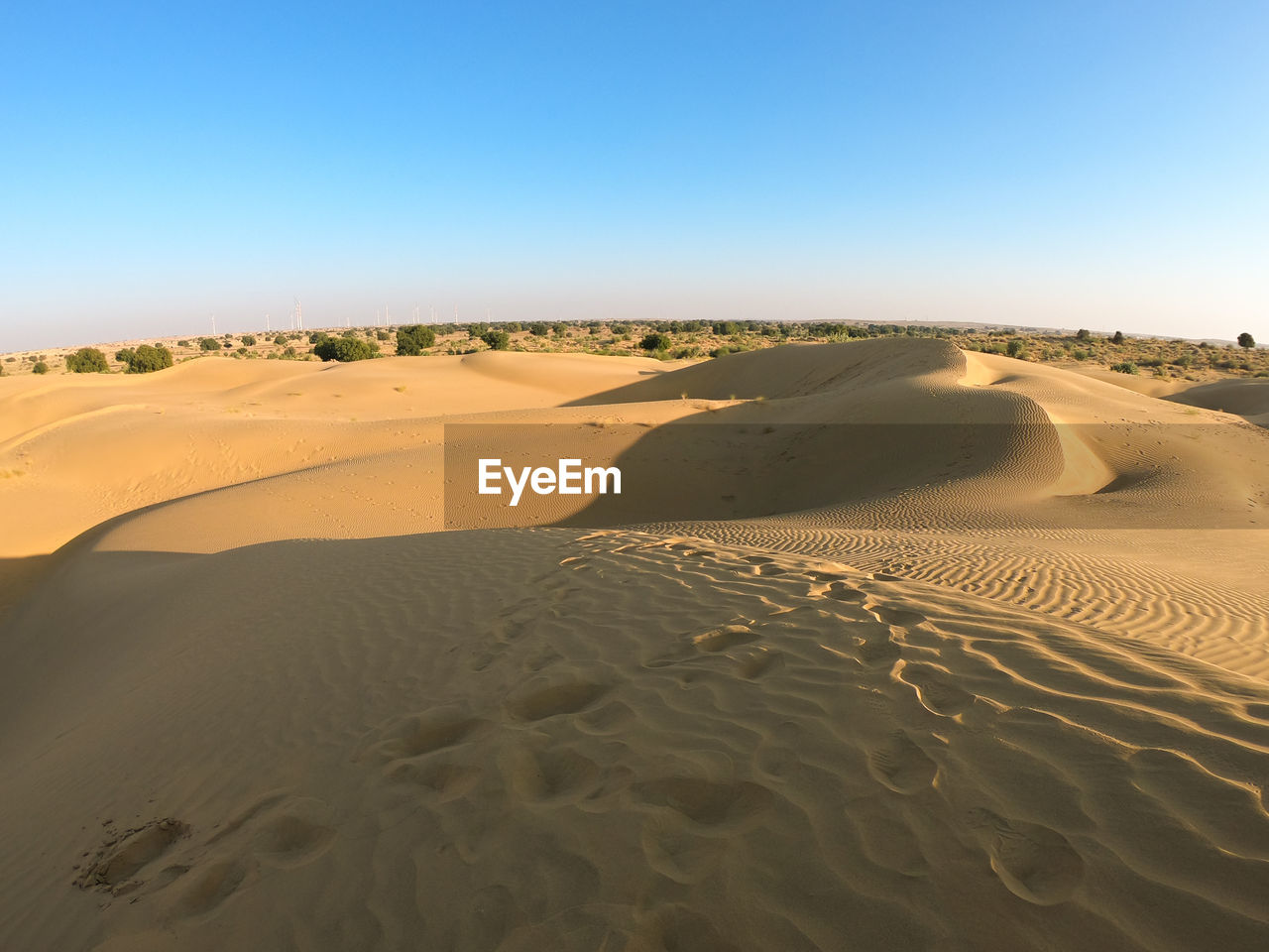 sand, desert, sand dune, sky, arid climate, scenics - nature, landscape, clear sky, land, climate, environment, beauty in nature, tranquility, tranquil scene, non-urban scene, day, nature, no people, remote, copy space, outdoors, atmospheric