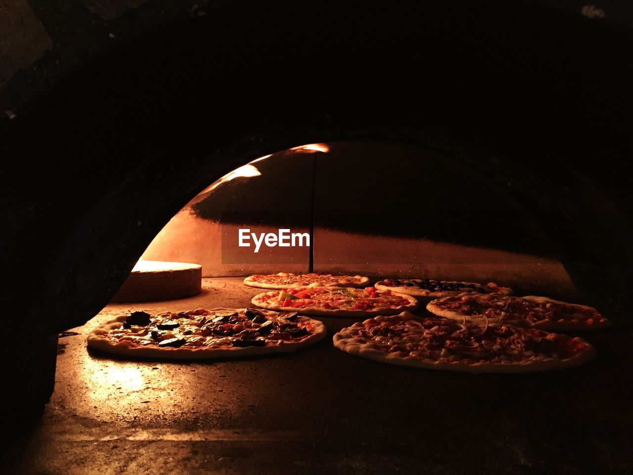 Close-up of pizza on oven