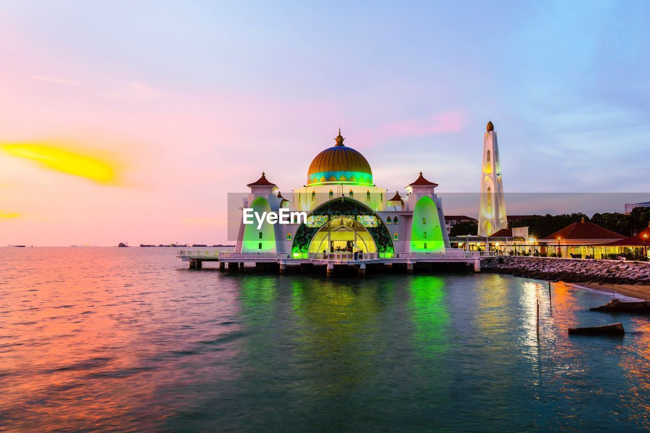 architecture, built structure, dome, water, sky, religion, spirituality, sunset, place of worship, waterfront, building exterior, cloud - sky, travel destinations, outdoors, illuminated, no people, nature, beauty in nature, day