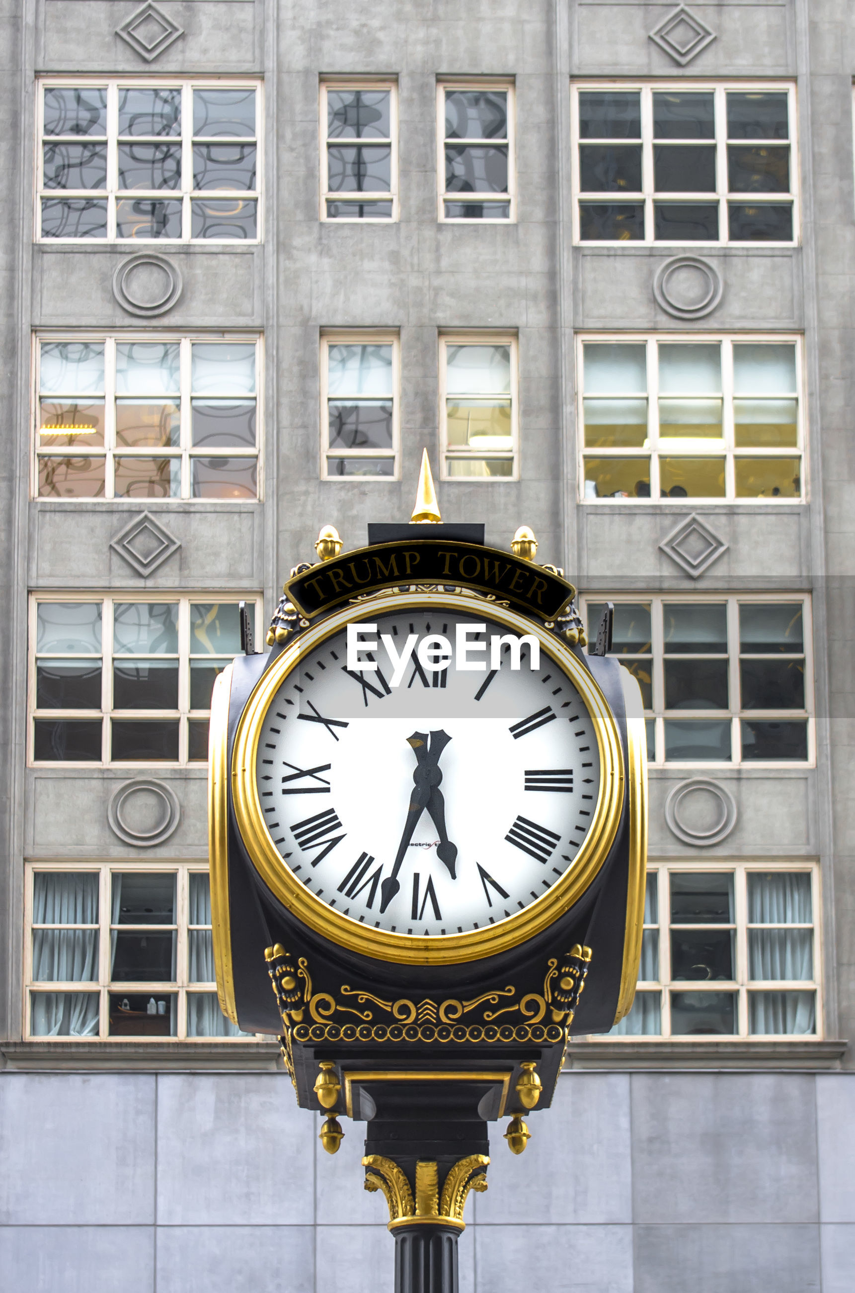 Low angle view of clock against building in city