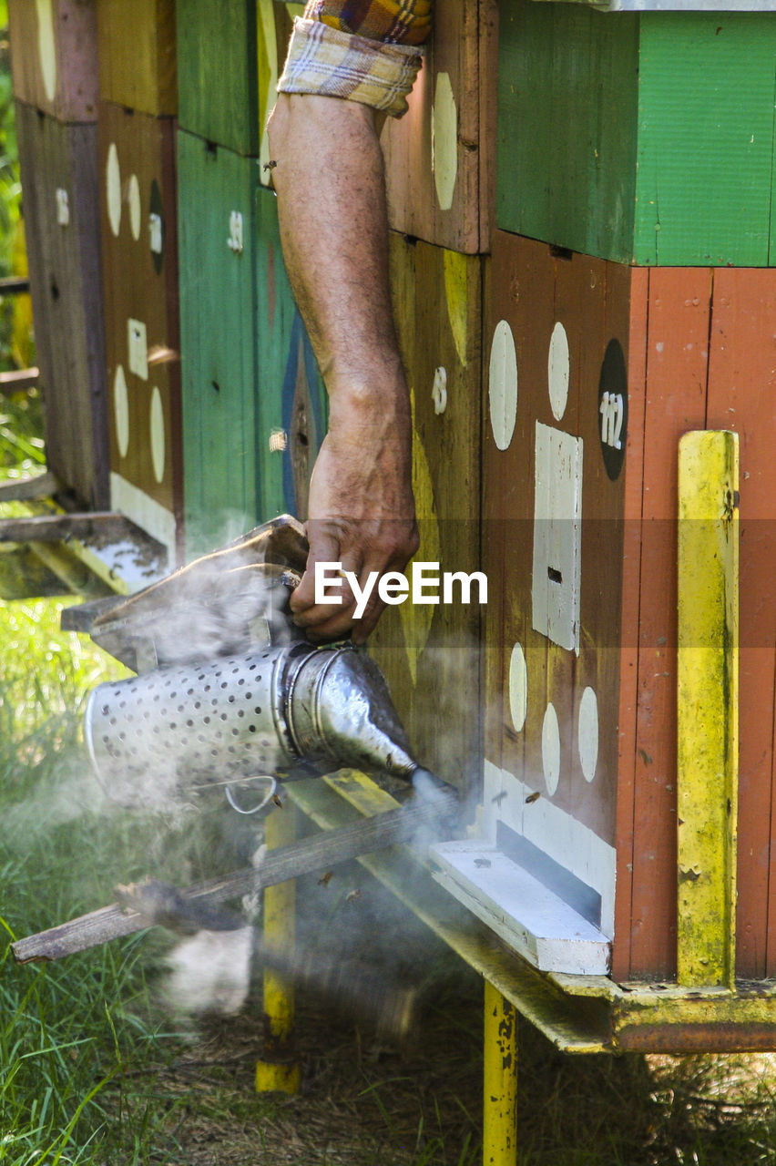 Man Working By Beehives