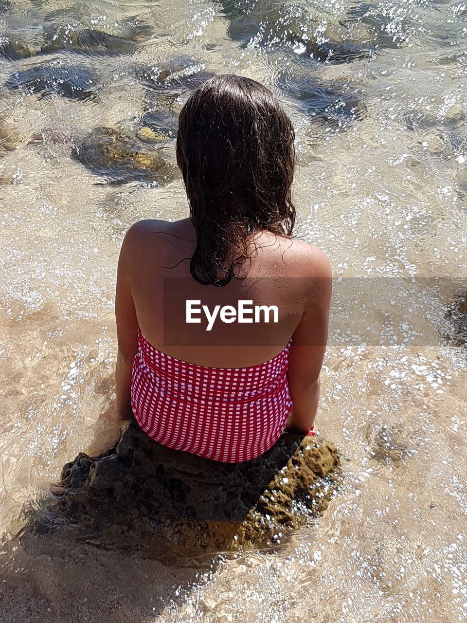 Sand Water One Person Beach Rear View Adults Only Wet One Woman Only Summer Adult Only Women Vacations Shadow People Women Day Young Adult One Young Woman Only Outdoors Close-up