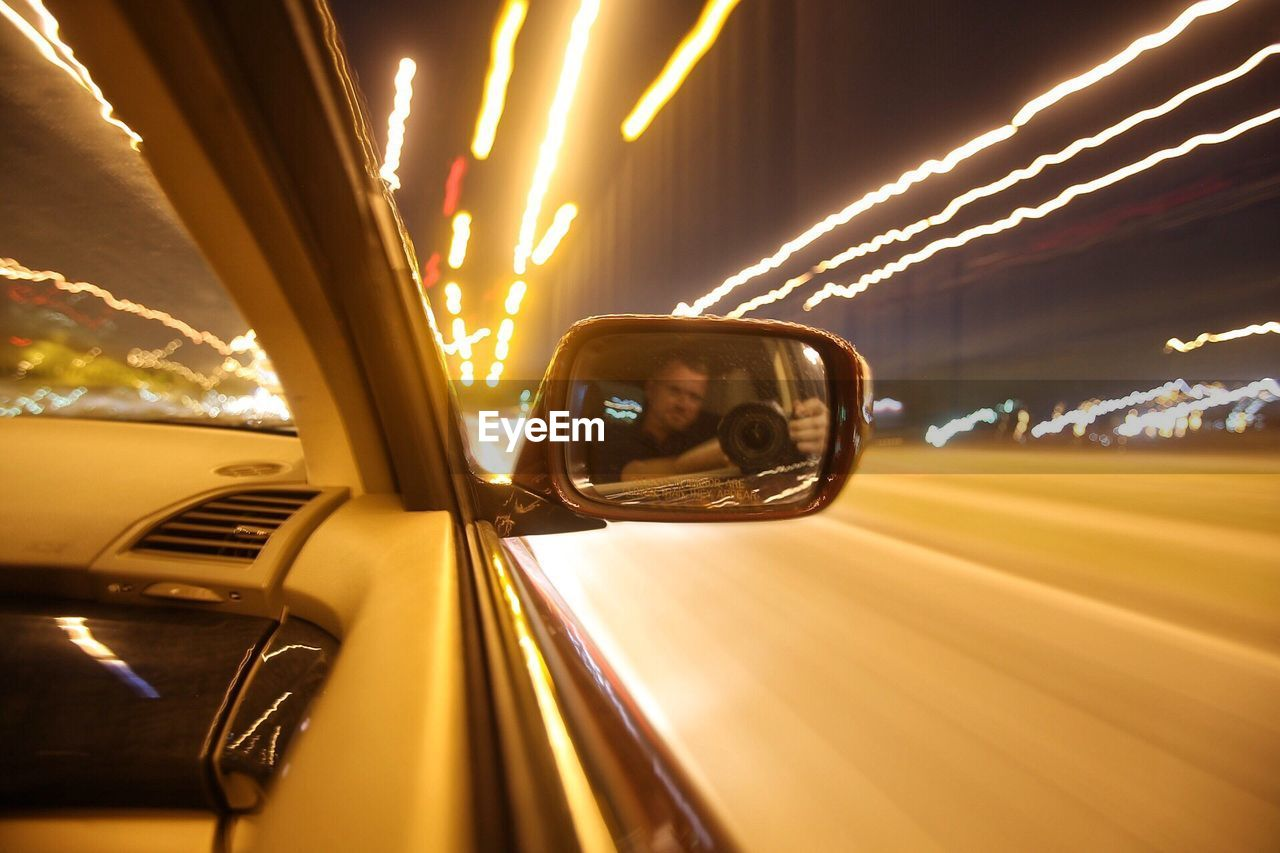 car, transportation, mode of transport, land vehicle, side-view mirror, reflection, illuminated, one person, indoors, sky, day