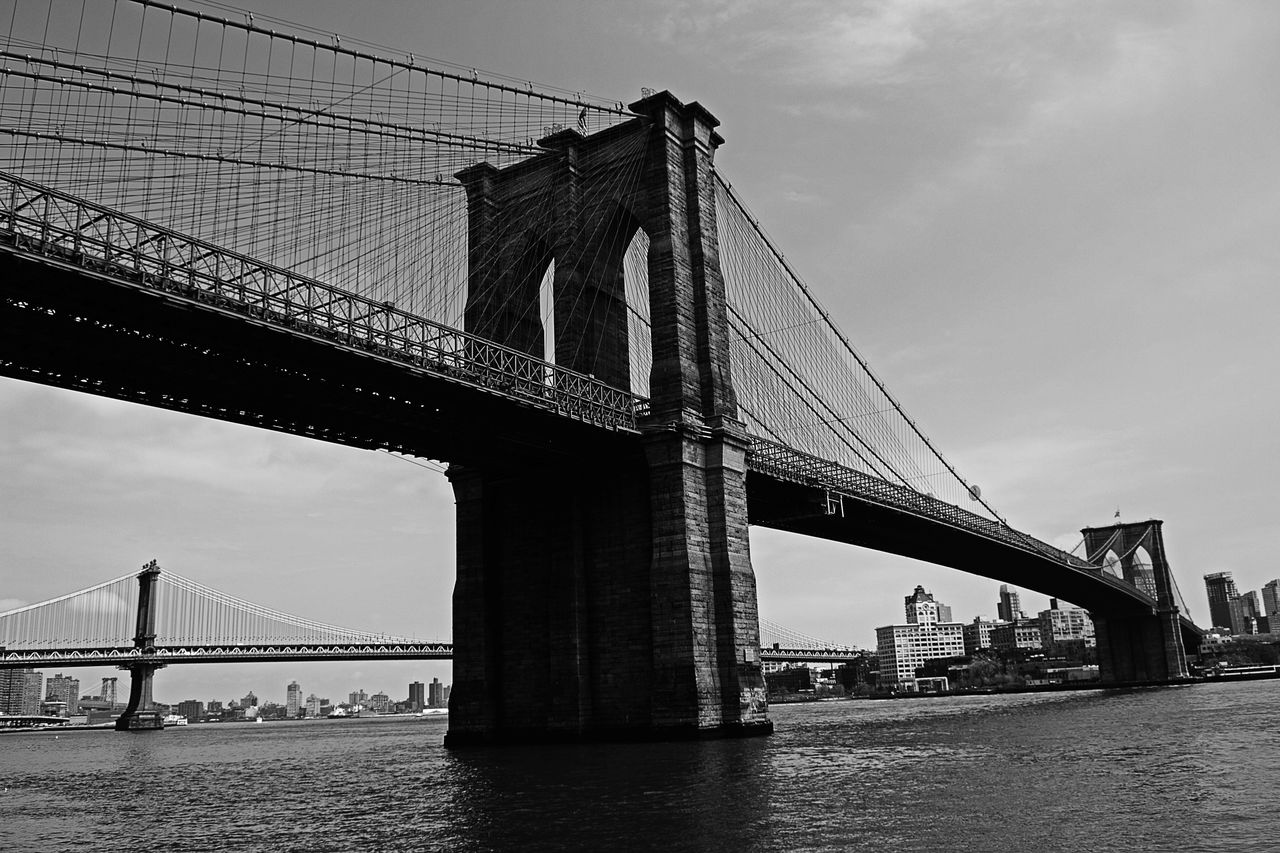 Low Angle View Of Brooklyn Bridge Over East River