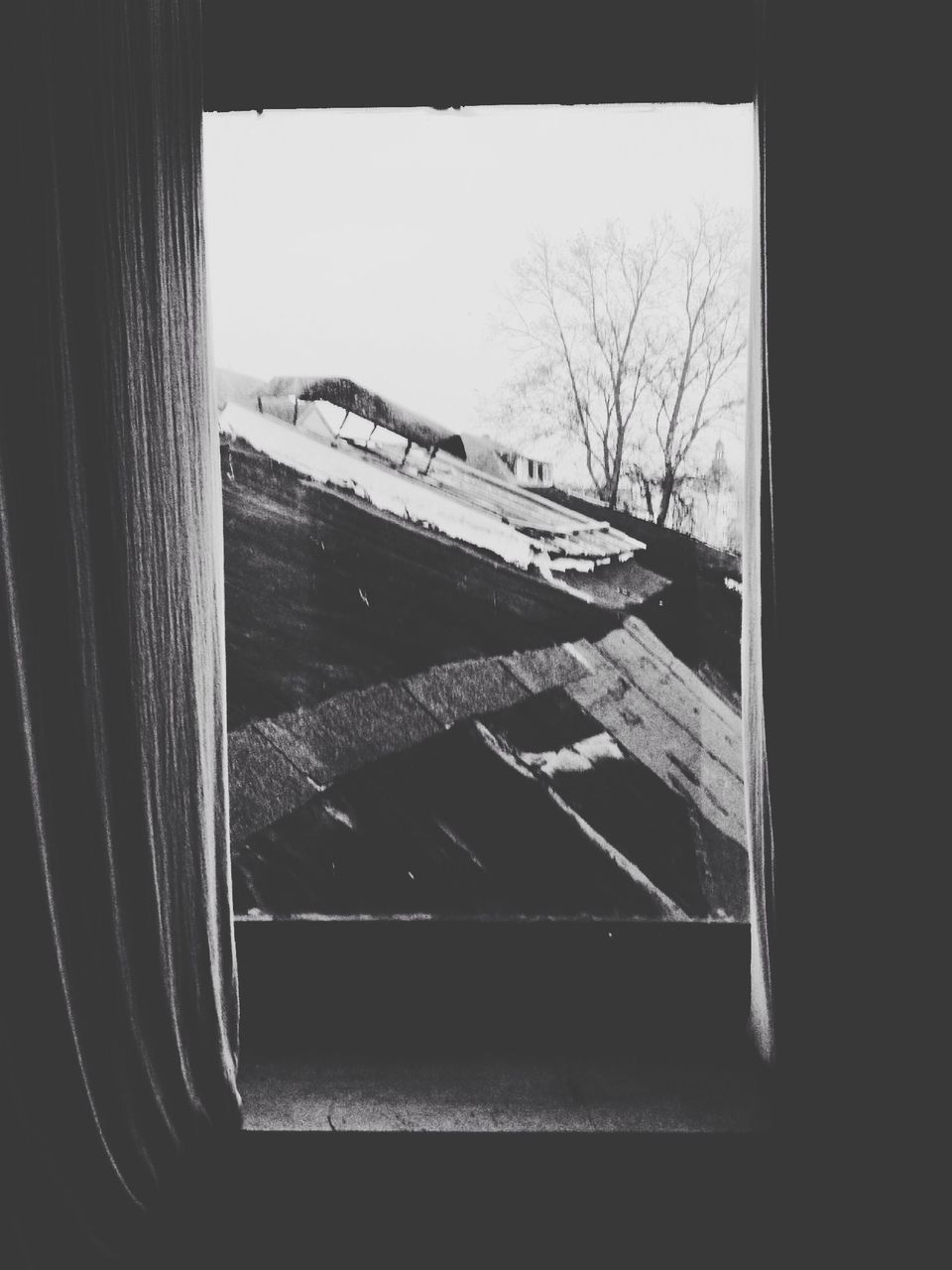 Old wooden structures seen through window