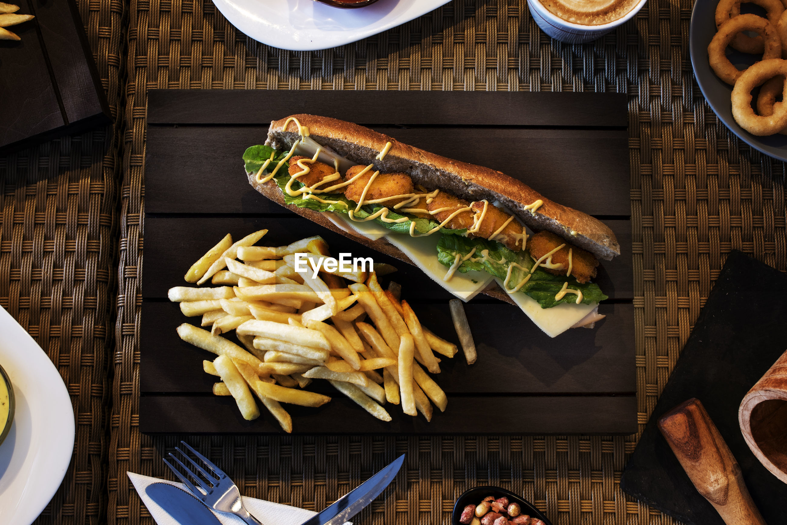 High angle view of sandwich and french fries on table