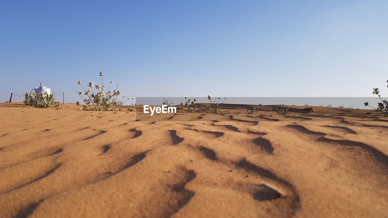 SURFACE LEVEL OF SAND DUNES AGAINST SKY