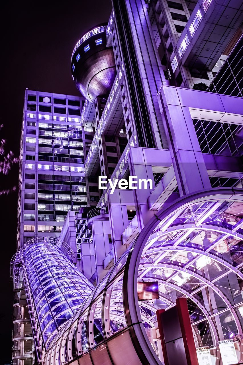 architecture, illuminated, built structure, night, building exterior, low angle view, purple, city, no people, metal, tall - high, modern, office building exterior, building, arts culture and entertainment, amusement park, sky, pattern, skyscraper, amusement park ride, steel