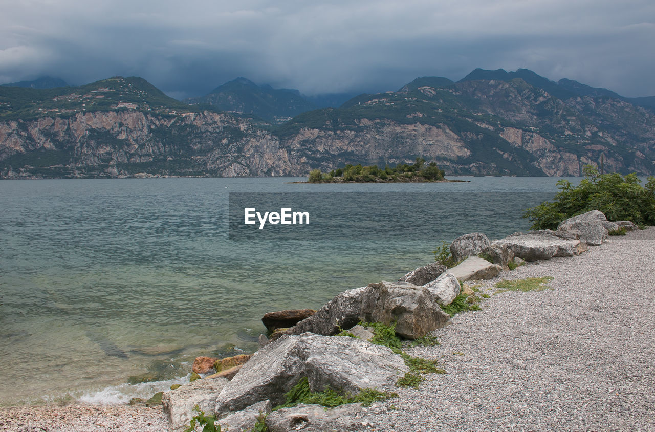 mountain, beauty in nature, sky, water, scenics - nature, rock, nature, cloud - sky, mountain range, rock - object, tranquility, tranquil scene, day, solid, sea, no people, outdoors, land, idyllic, mountain peak
