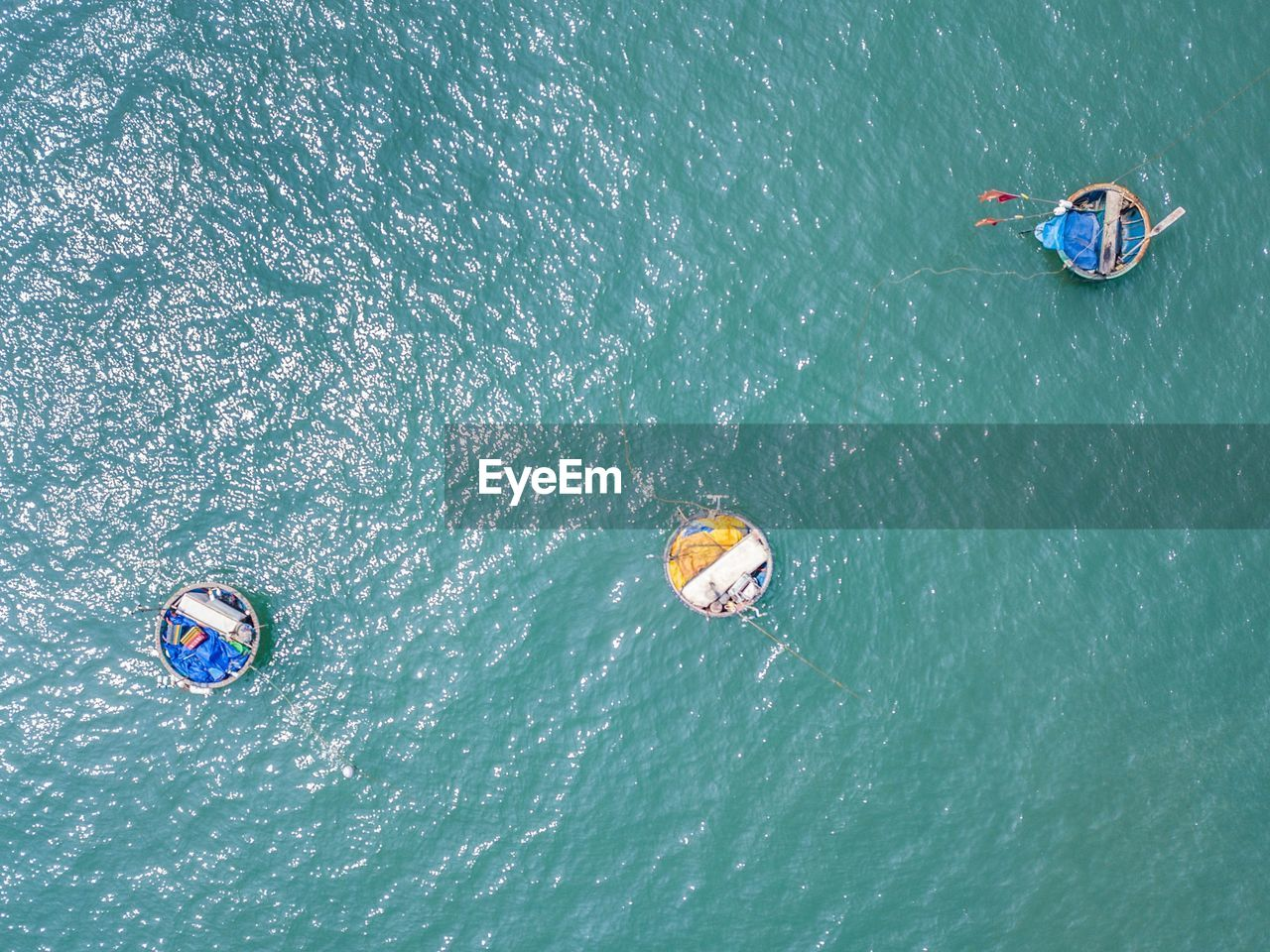 HIGH ANGLE VIEW OF PEOPLE FLOATING ON WATER