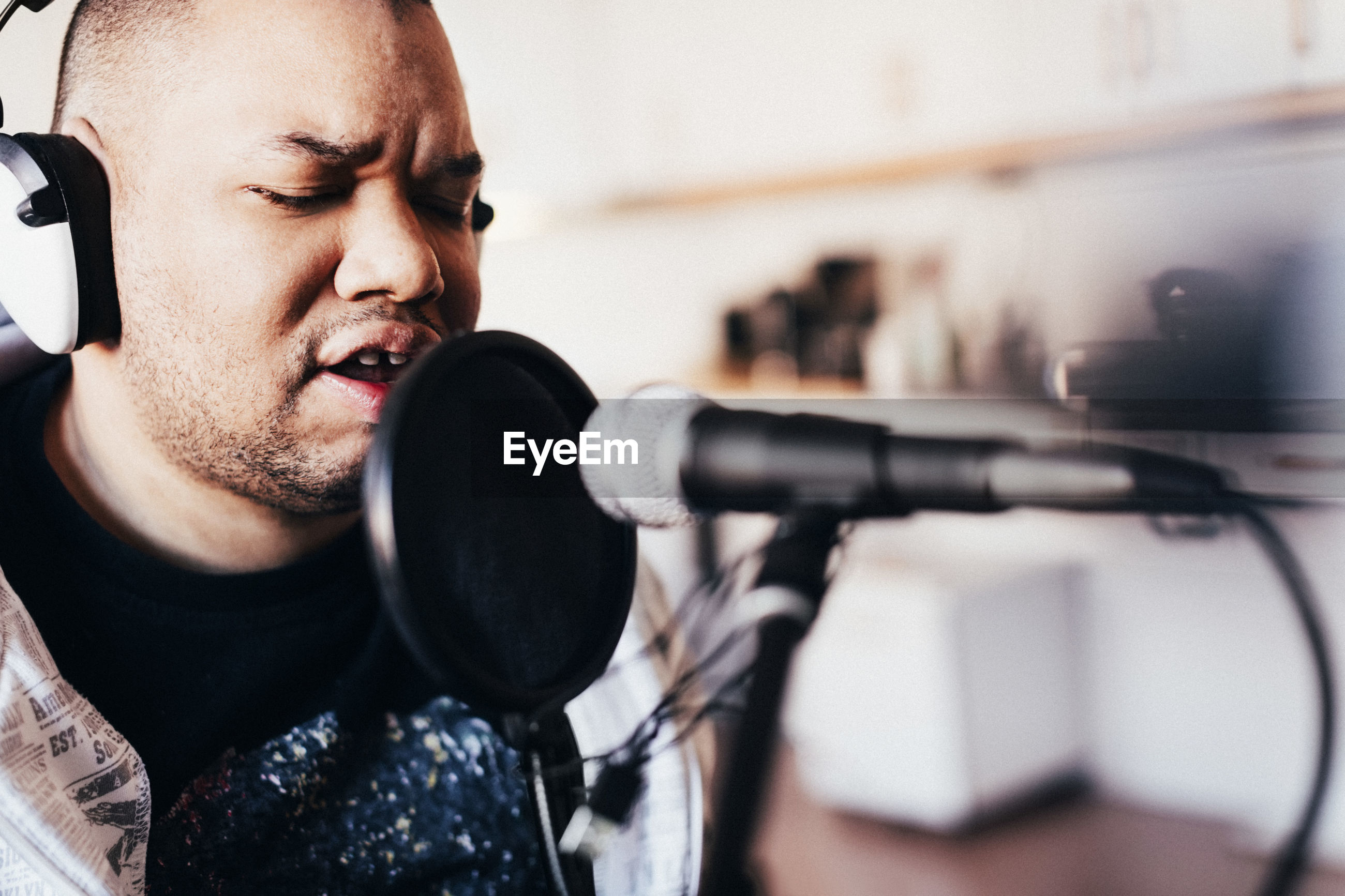 Disabled male singer singing in recording studio