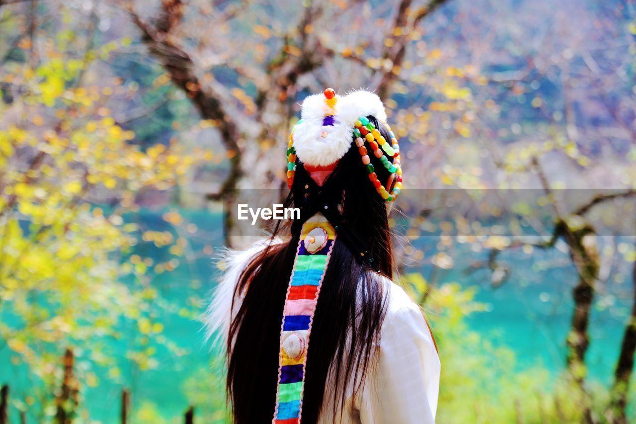 Rear View Of Woman Wearing Traditional Headdress