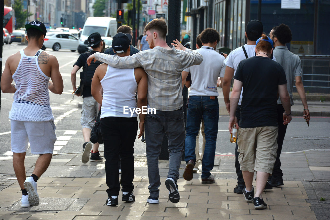 rear view, street, walking, city, men, outdoors, real people, day, full length, large group of people, togetherness, adult, people