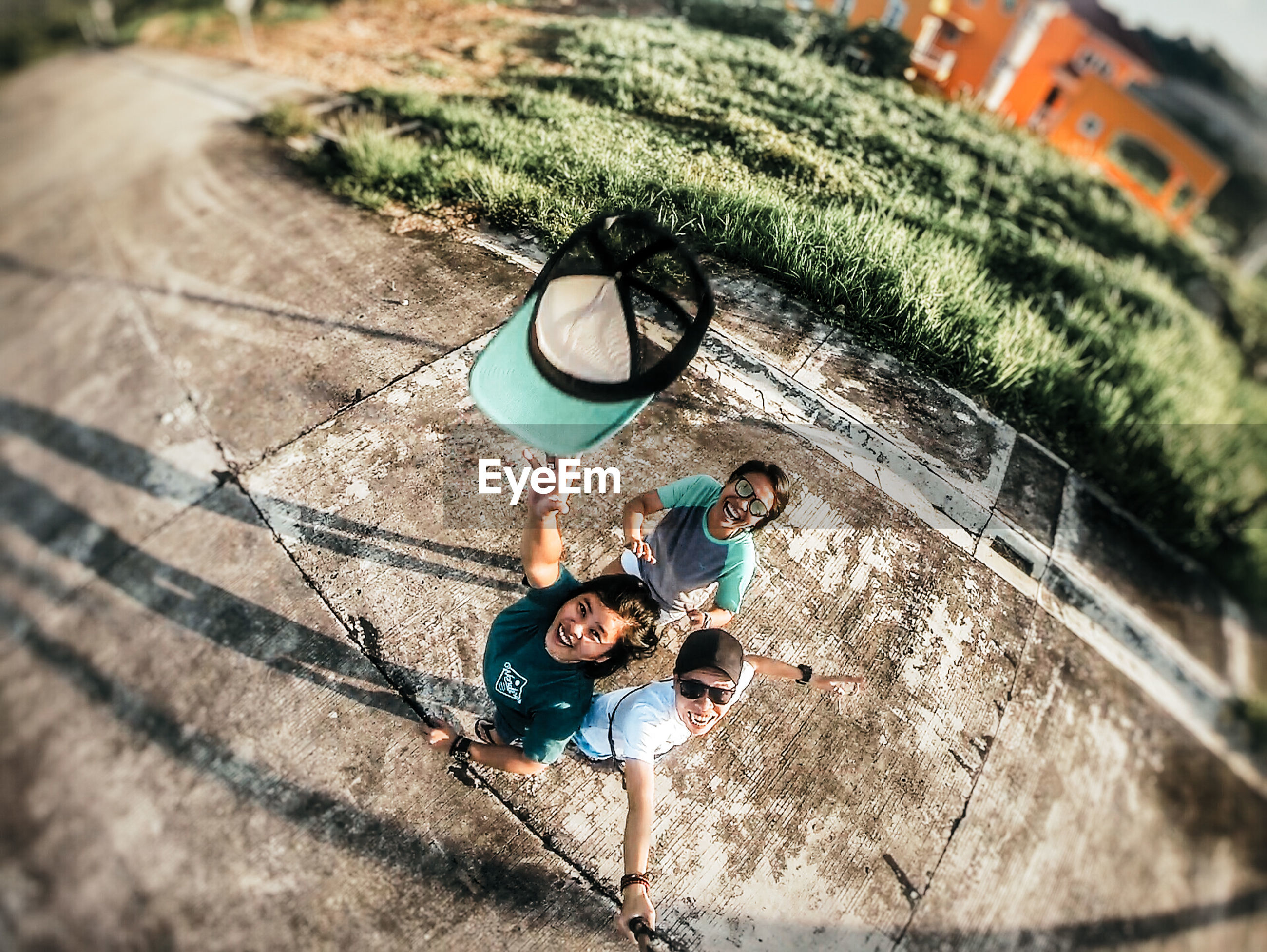 high angle view, togetherness, men, full length, real people, leisure activity, lifestyles, young men, group of people, nature, young adult, day, males, childhood, child, bonding, casual clothing, people, outdoors, friendship, positive emotion