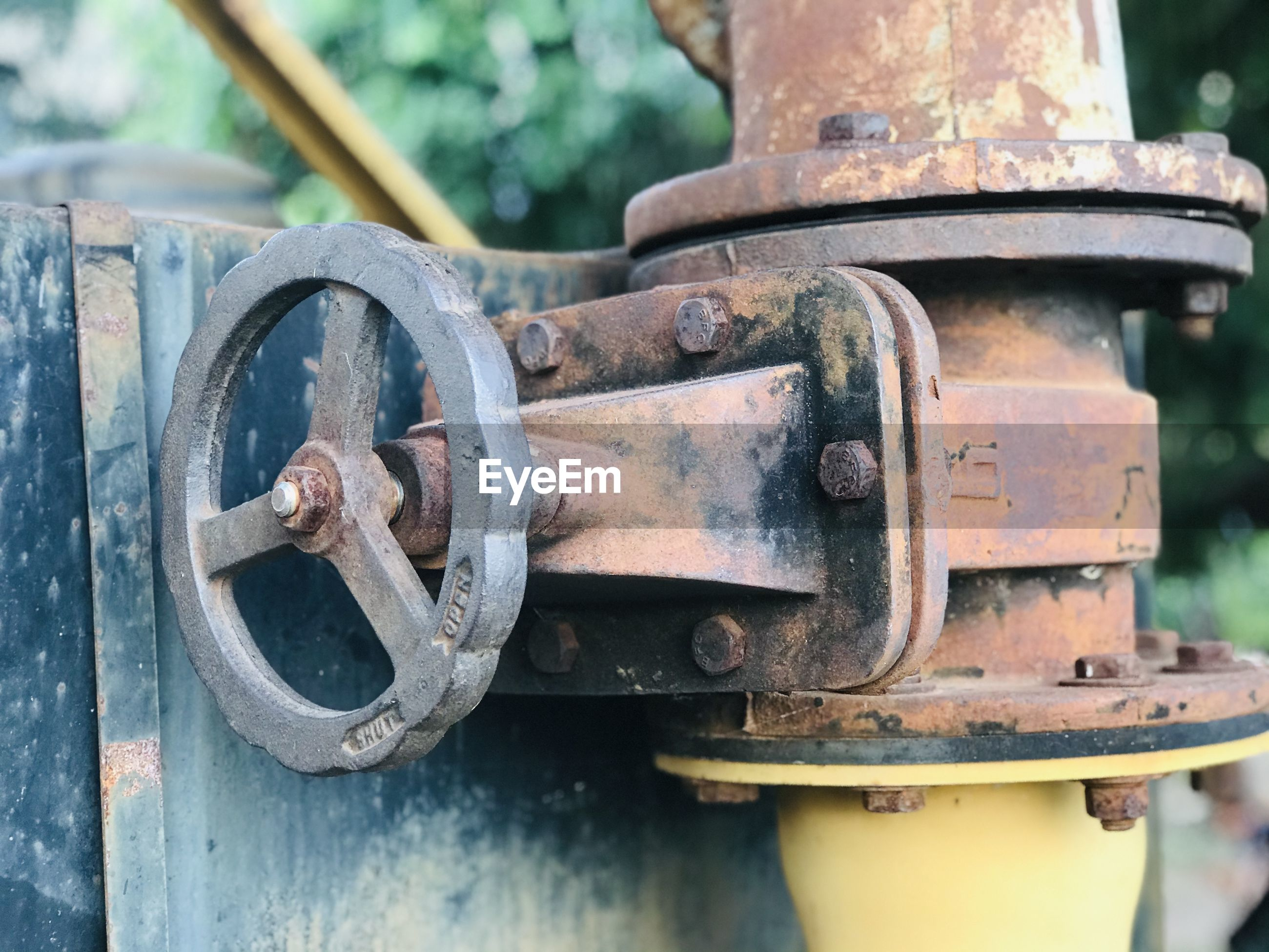 Close-up of rusty machine part outdoors