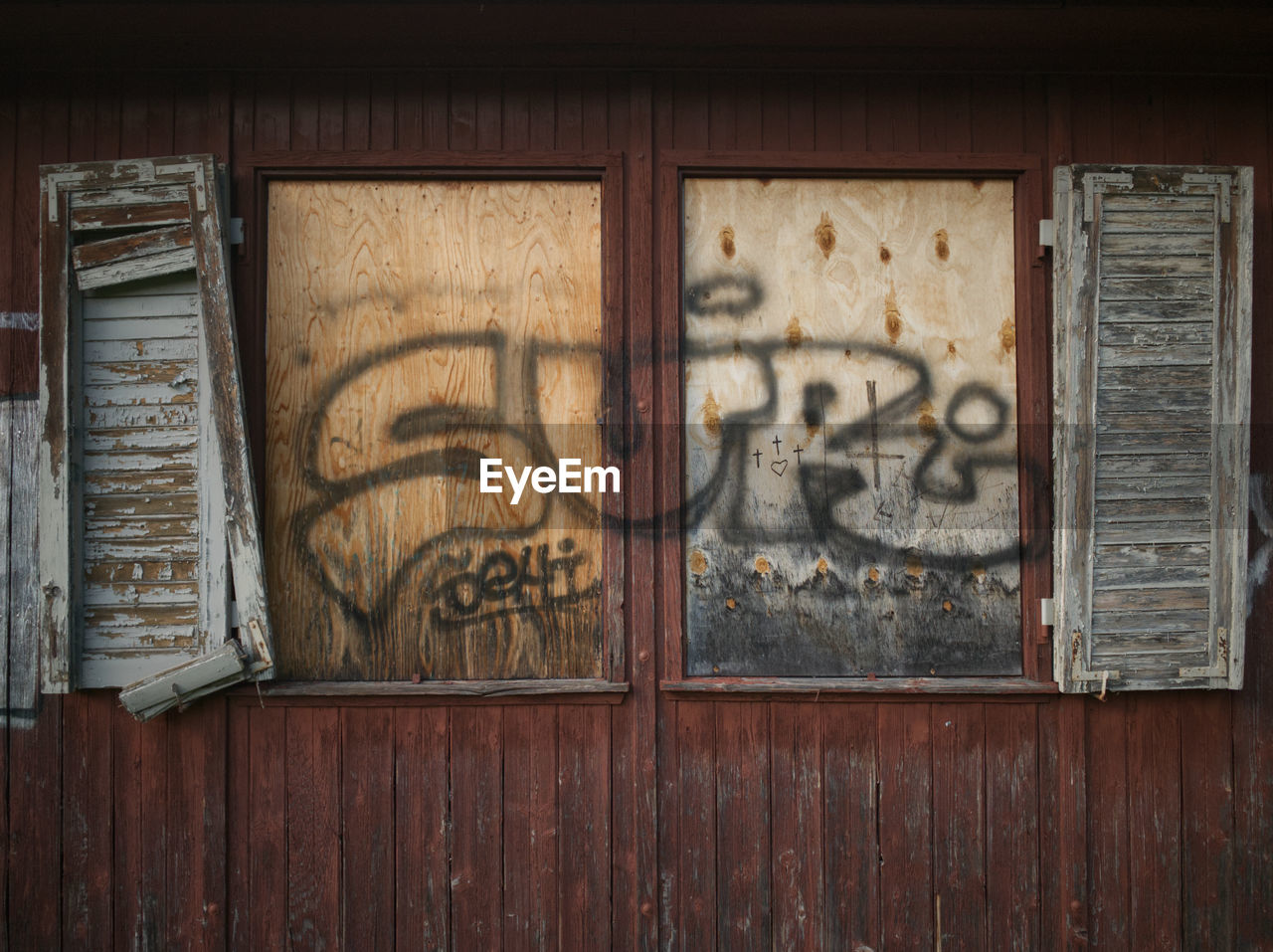 wood - material, no people, architecture, wall - building feature, built structure, day, graffiti, text, old, building exterior, art and craft, creativity, weathered, craft, brown, outdoors, wood, window