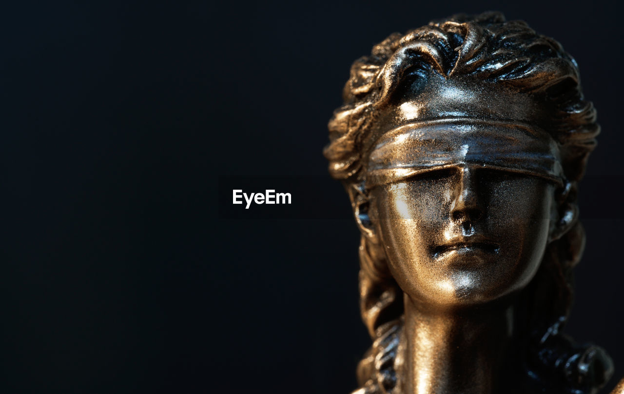 sculpture, statue, representation, human representation, creativity, art and craft, male likeness, no people, close-up, indoors, craft, belief, religion, spirituality, copy space, metal, black background, studio shot, gold colored, focus on foreground