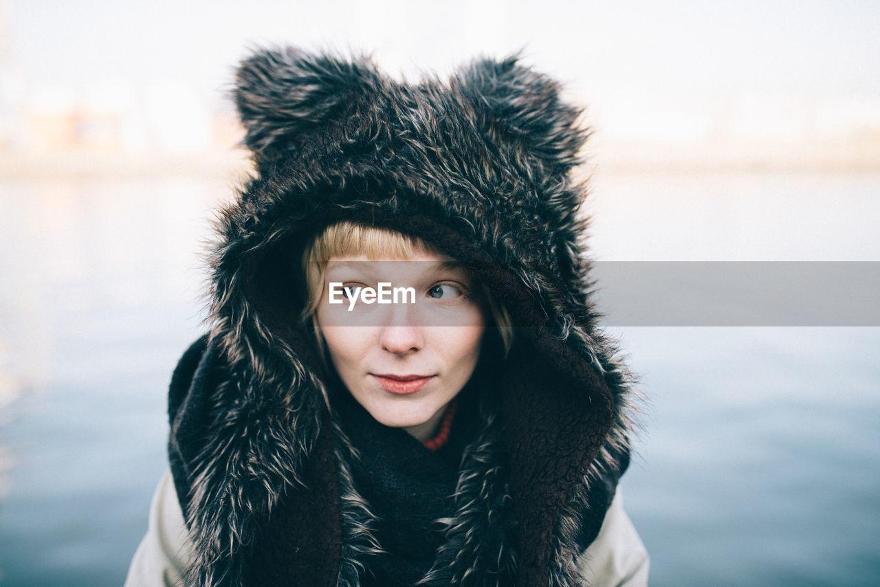 Woman In Fur Coat Against Sky