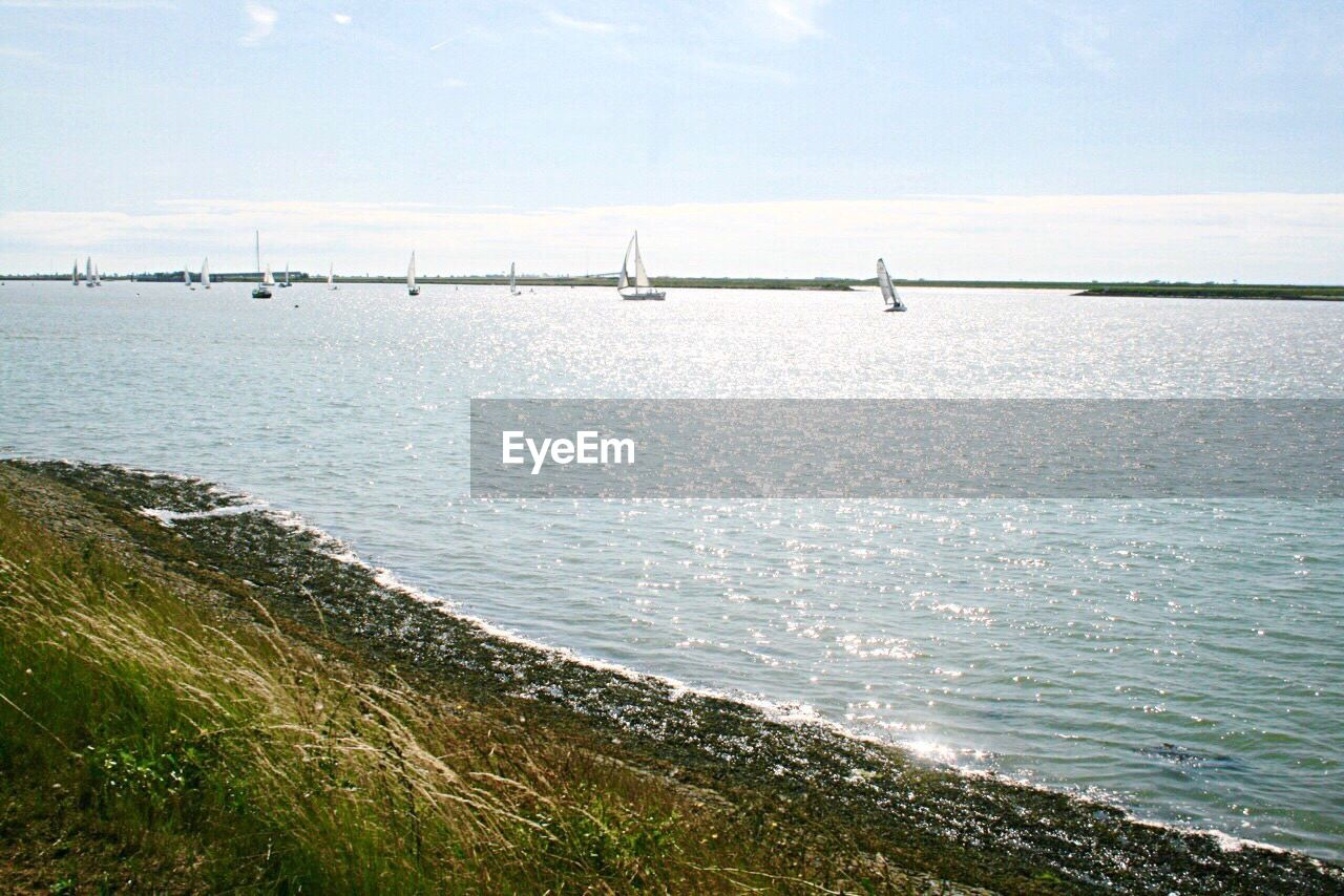 sea, water, tranquil scene, nature, tranquility, day, scenics, beauty in nature, horizon over water, outdoors, sky, beach, no people, nautical vessel