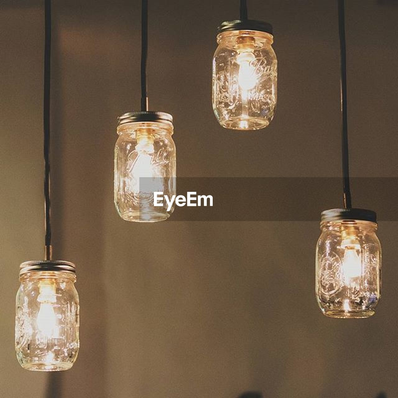 lighting equipment, electricity, light bulb, illuminated, hanging, filament, glowing, electric light, bulb, electric lamp, no people, technology, cable, innovation, fuel and power generation, low angle view, close-up, indoors, lantern, day