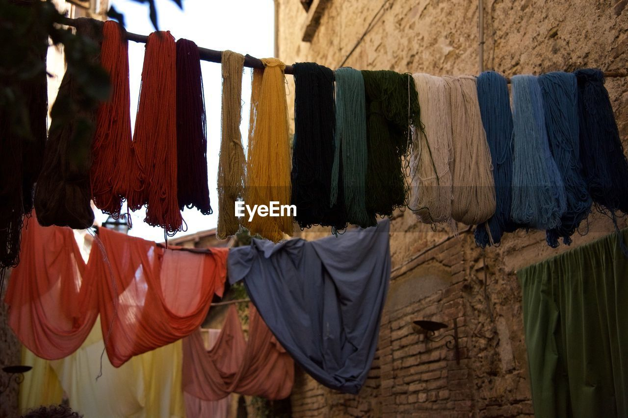 Strings Of Wool And Fabric Hung Out To Dry