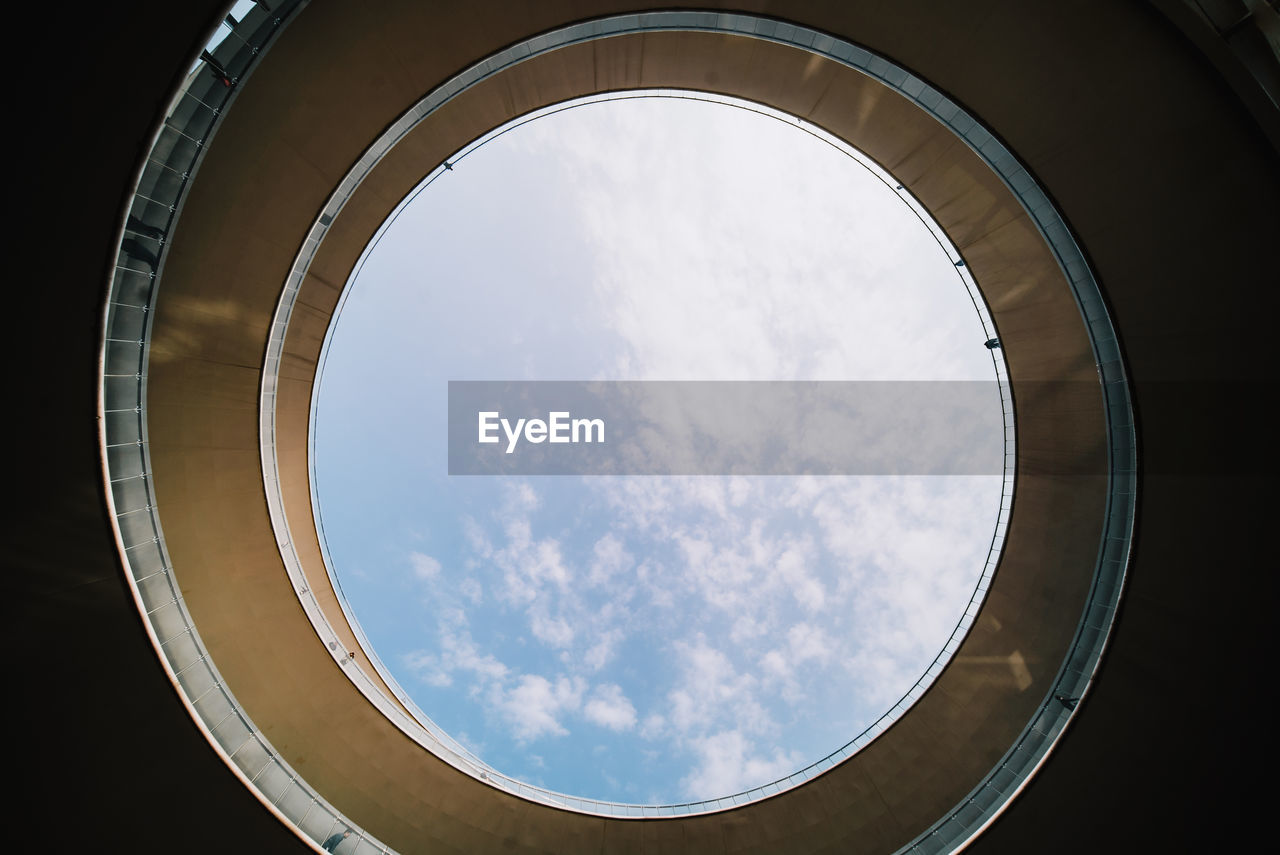 sky, cloud - sky, geometric shape, circle, low angle view, shape, architecture, built structure, nature, no people, day, design, window, indoors, directly below, pattern, sunlight, transparent, glass - material, architecture and art