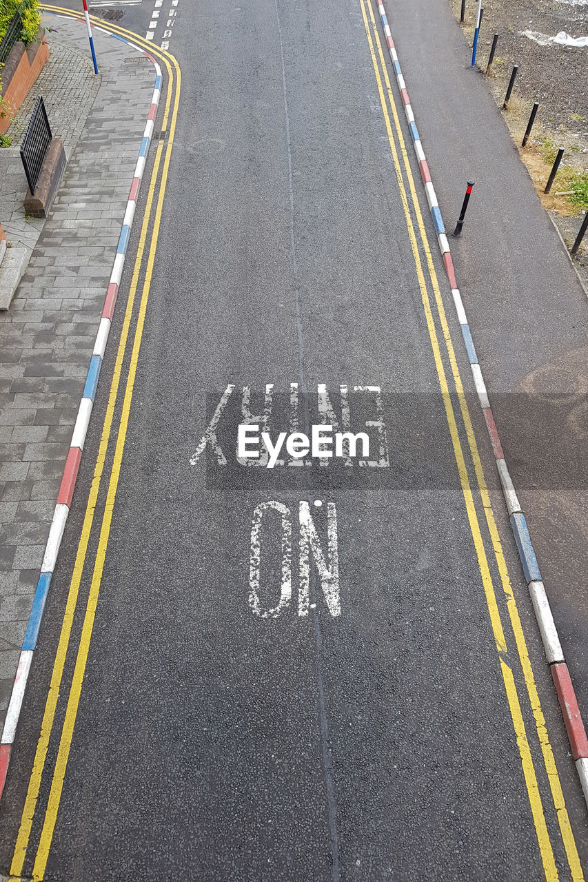 road, sign, symbol, transportation, high angle view, marking, text, road marking, communication, direction, western script, street, day, city, the way forward, asphalt, guidance, outdoors, arrow symbol, capital letter, dividing line