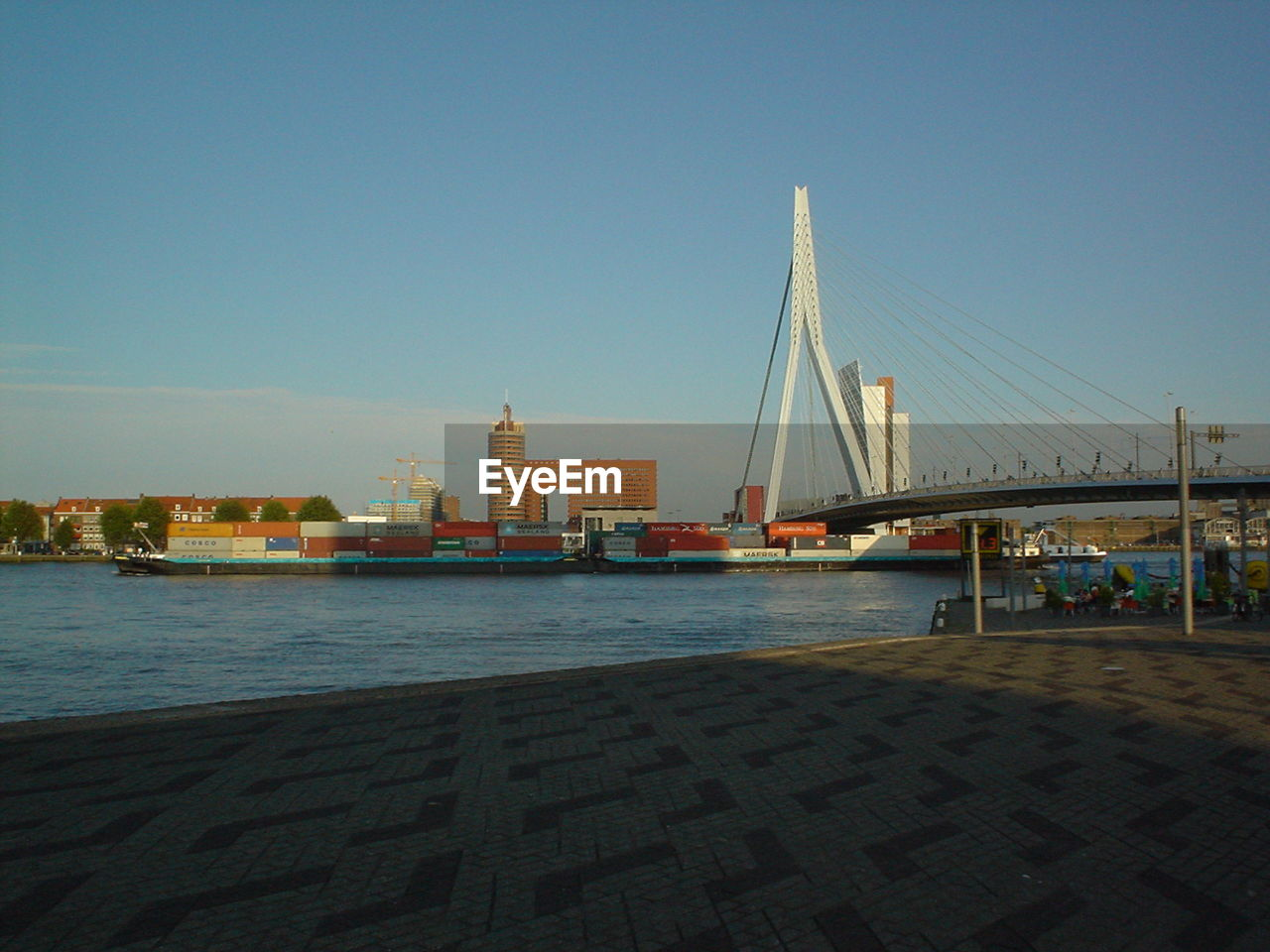 architecture, built structure, clear sky, city, water, building exterior, bridge - man made structure, outdoors, river, skyscraper, day, no people, cityscape, sky, urban skyline