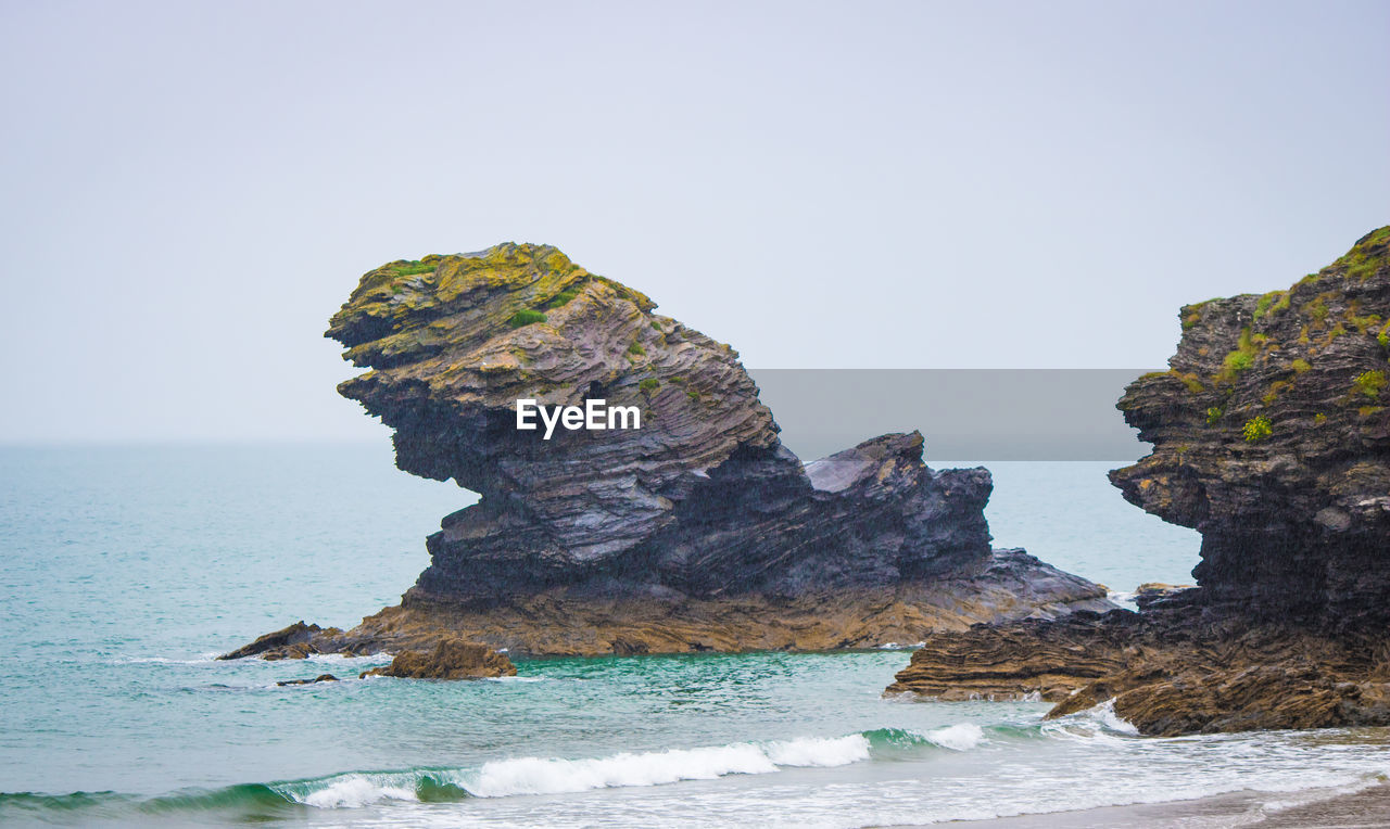 sea, rock formation, rock - object, nature, beauty in nature, scenics, tranquility, water, tranquil scene, clear sky, horizon over water, sky, no people, waterfront, physical geography, outdoors, day