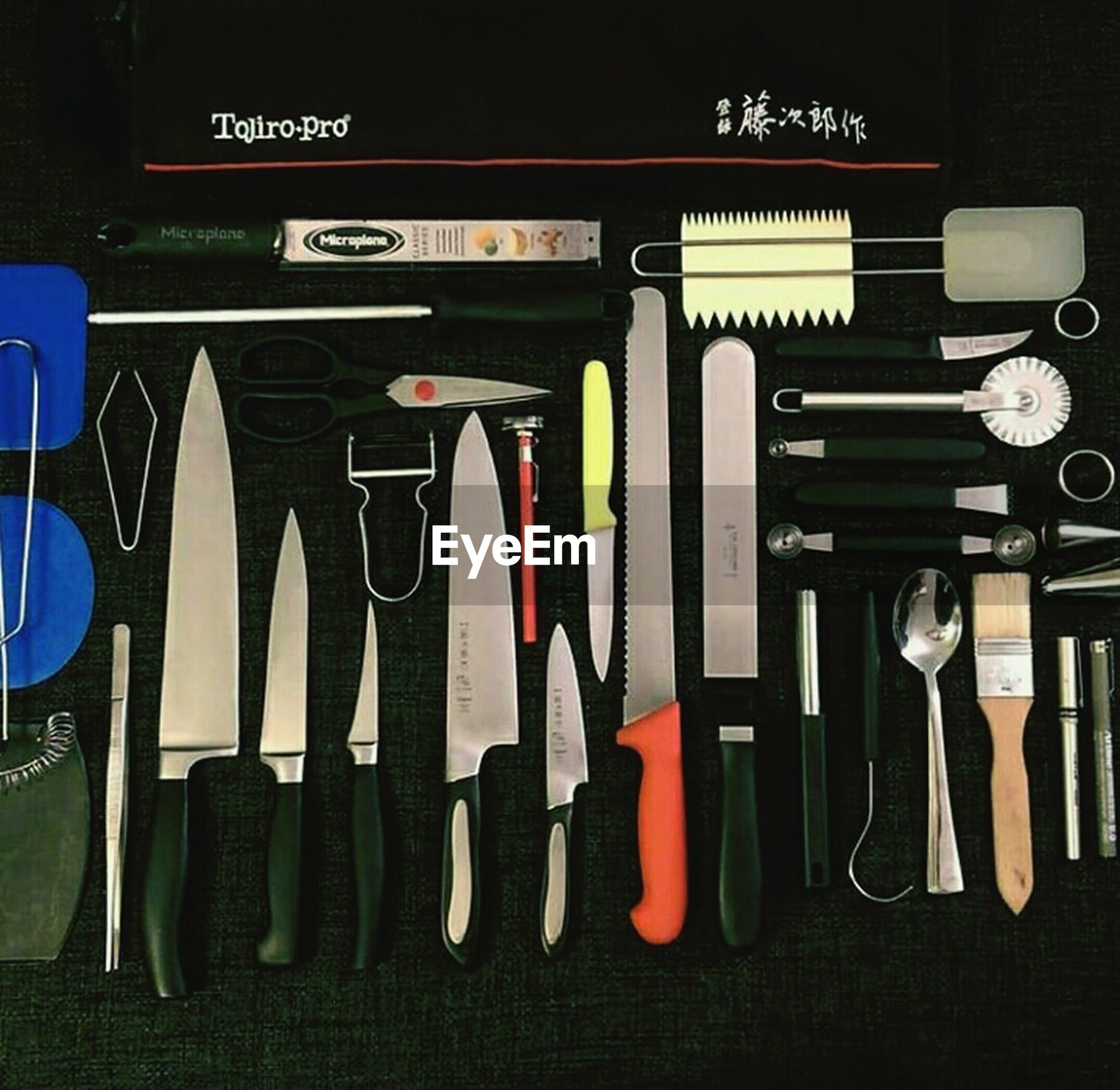 large group of objects, work tool, variation, no people, directly above, indoors, wrench, day