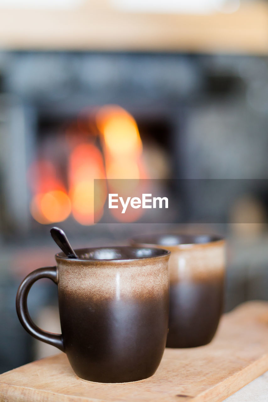 coffee - drink, coffee cup, drink, food and drink, heat - temperature, refreshment, table, close-up, no people, focus on foreground, freshness, indoors, day