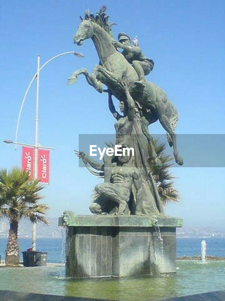 statue, water, travel destinations, sculpture, day, sky, outdoors, waterfront, clear sky, no people, city