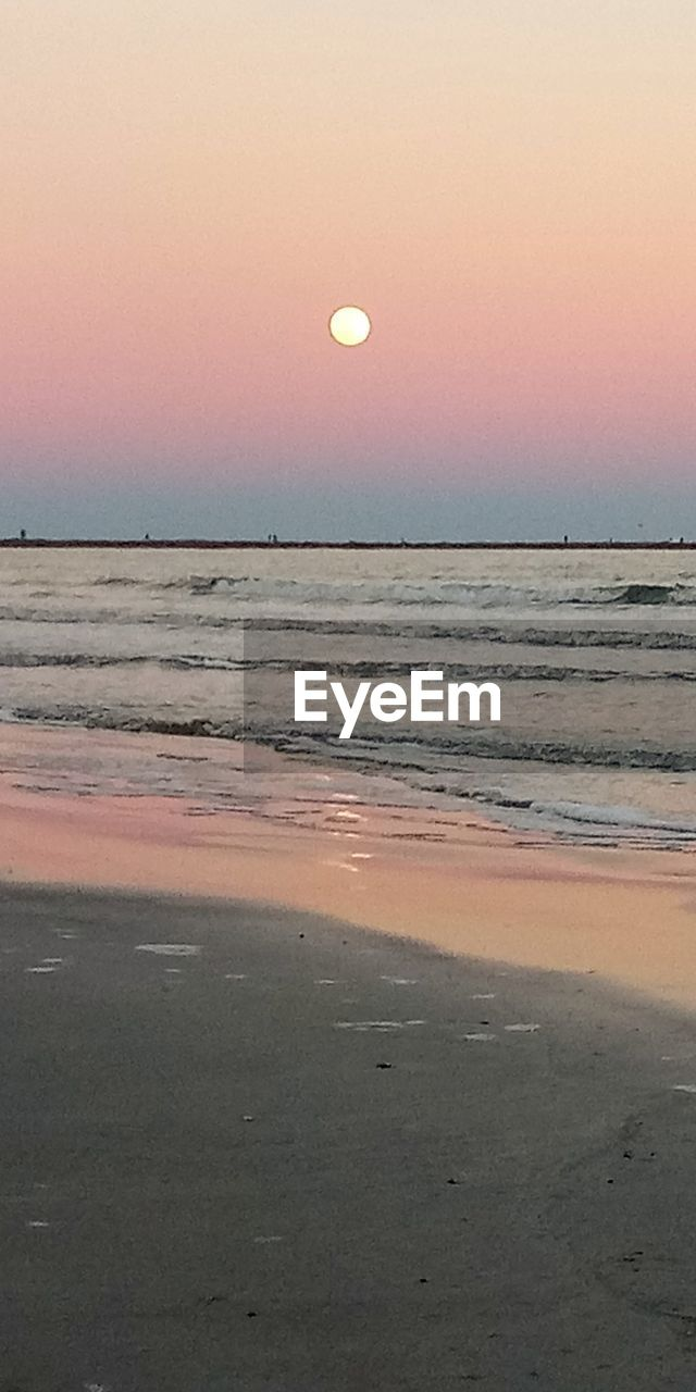 sky, scenics - nature, beauty in nature, sunset, sea, water, horizon over water, tranquil scene, horizon, tranquility, beach, land, idyllic, nature, no people, orange color, moon, outdoors, clear sky
