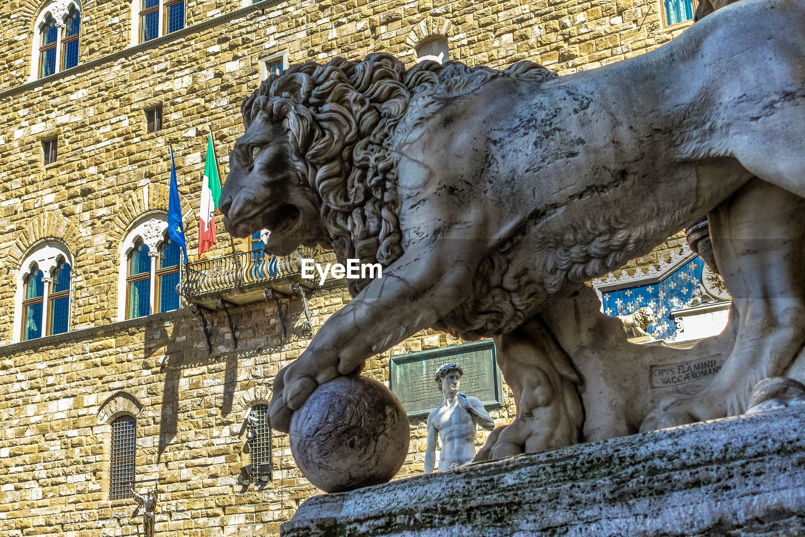 Low angle view of lion statue against historic building