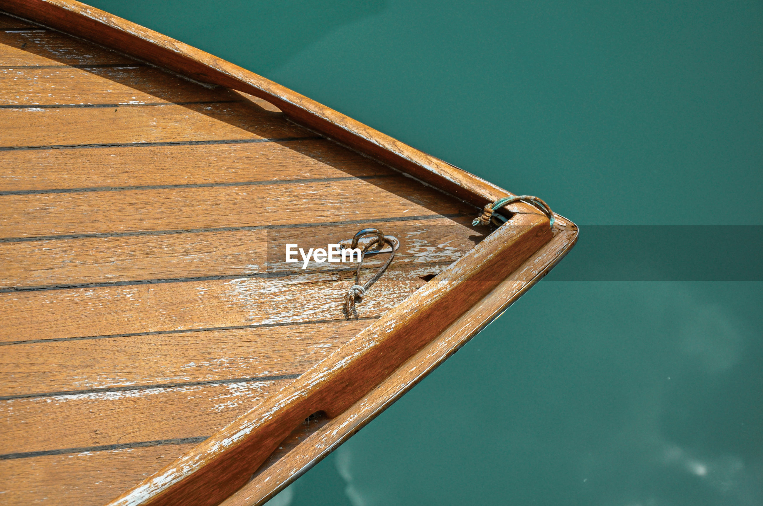 Close-up of boat bow made of wood at murano, a small and pleasant town near venice, italy.