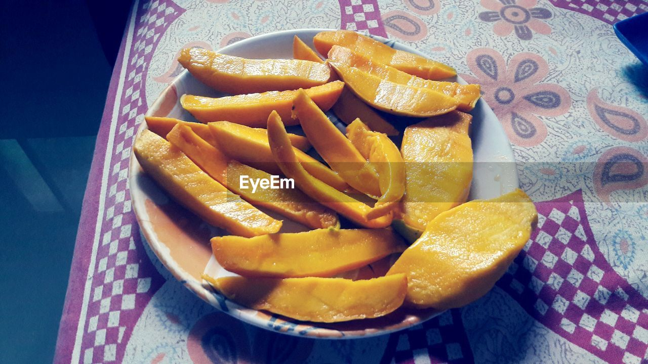 food, food and drink, freshness, ready-to-eat, healthy eating, indoors, high angle view, potato, still life, table, close-up, french fries, slice, prepared potato, no people, wellbeing, snack, fruit, vegetable, bowl, temptation, orange