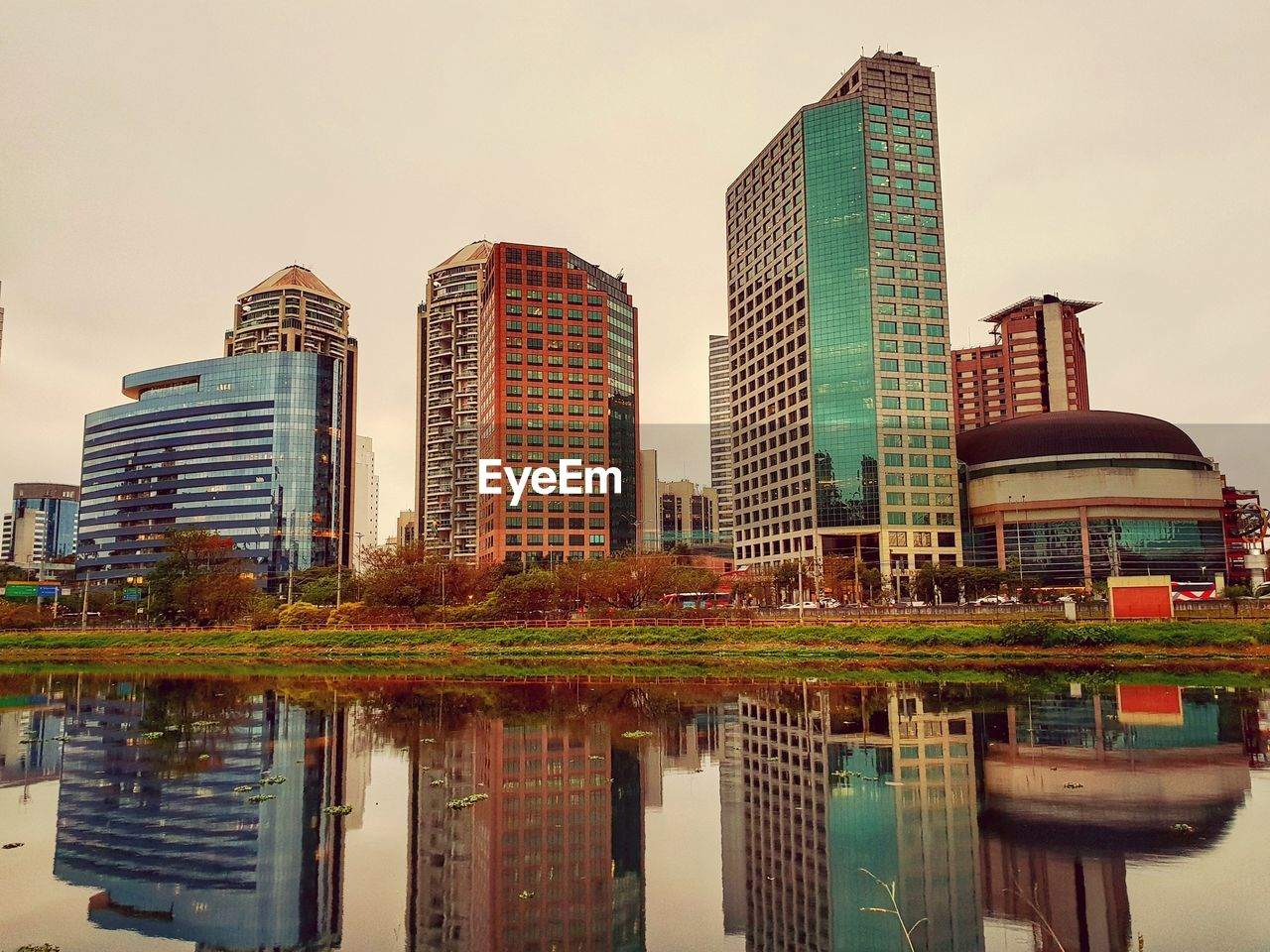building exterior, built structure, architecture, building, city, sky, reflection, water, waterfront, office building exterior, nature, modern, no people, office, outdoors, skyscraper, tower, tall - high, residential district, financial district