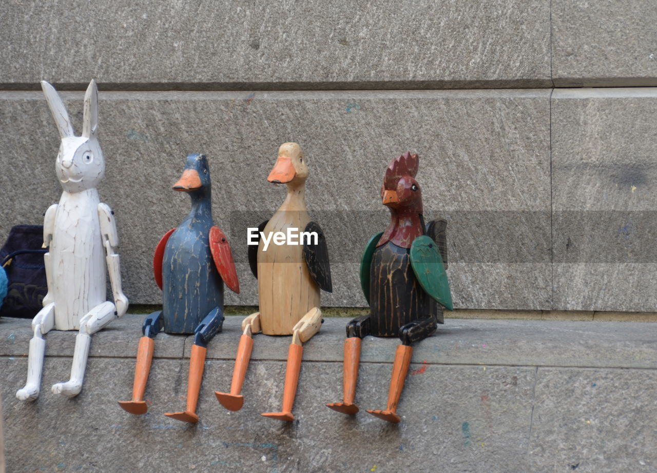 Animal Figurines Against Wall