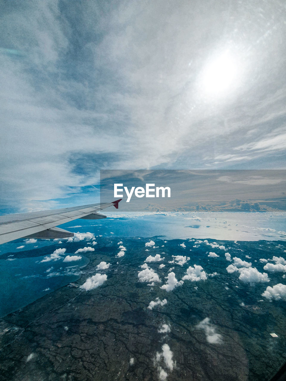 sky, cloud - sky, beauty in nature, scenics - nature, water, day, nature, tranquil scene, tranquility, sea, aerial view, flying, no people, transportation, airplane, horizon, non-urban scene, air vehicle, idyllic