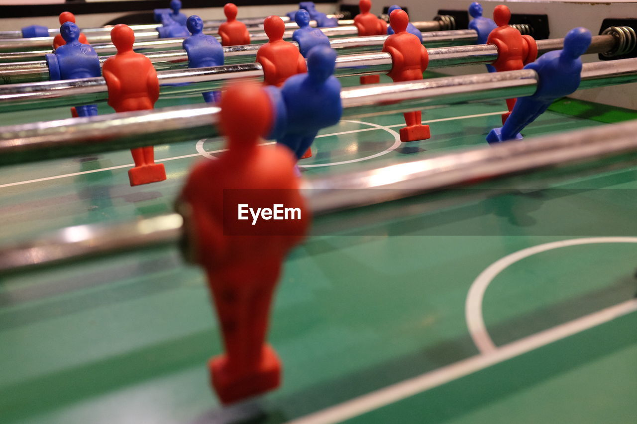 sport, leisure games, soccer, leisure activity, competition, team sport, relaxation, human representation, representation, figurine, teamwork, male likeness, cooperation, indoors, people, playing, high angle view, in a row, competitive sport, selective focus