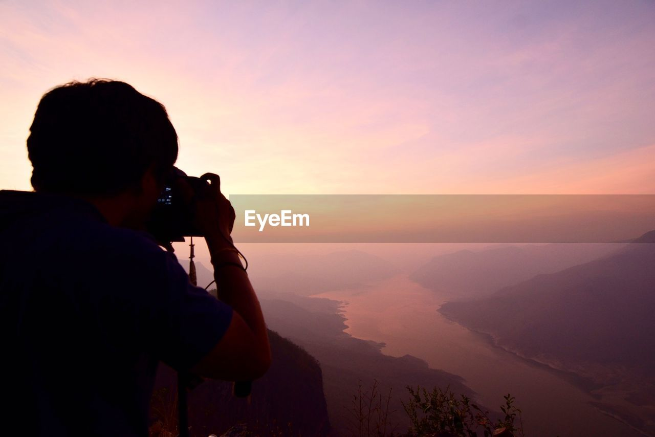 PHOTOGRAPHER PHOTOGRAPHING SUNSET