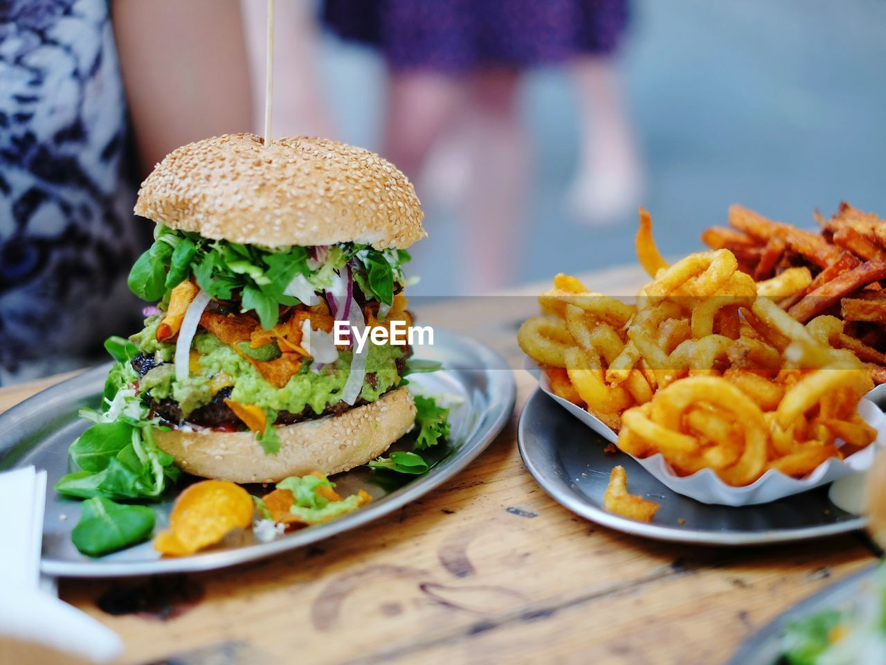 Close-Up Of Burger And French Fries In Plate On Table
