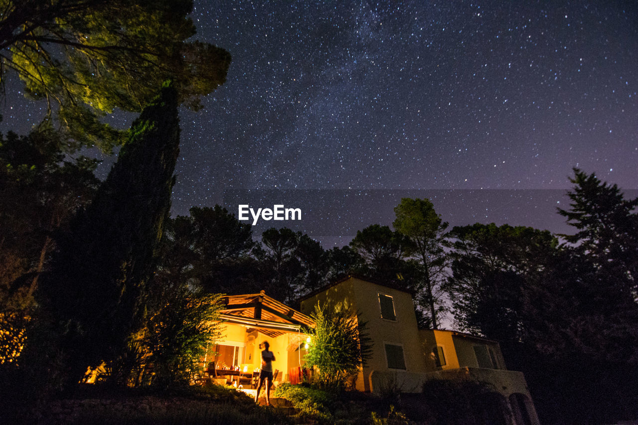 night, star - space, architecture, tree, building, sky, illuminated, astronomy, house, built structure, plant, building exterior, space, star, nature, galaxy, no people, star field, residential district, low angle view, outdoors