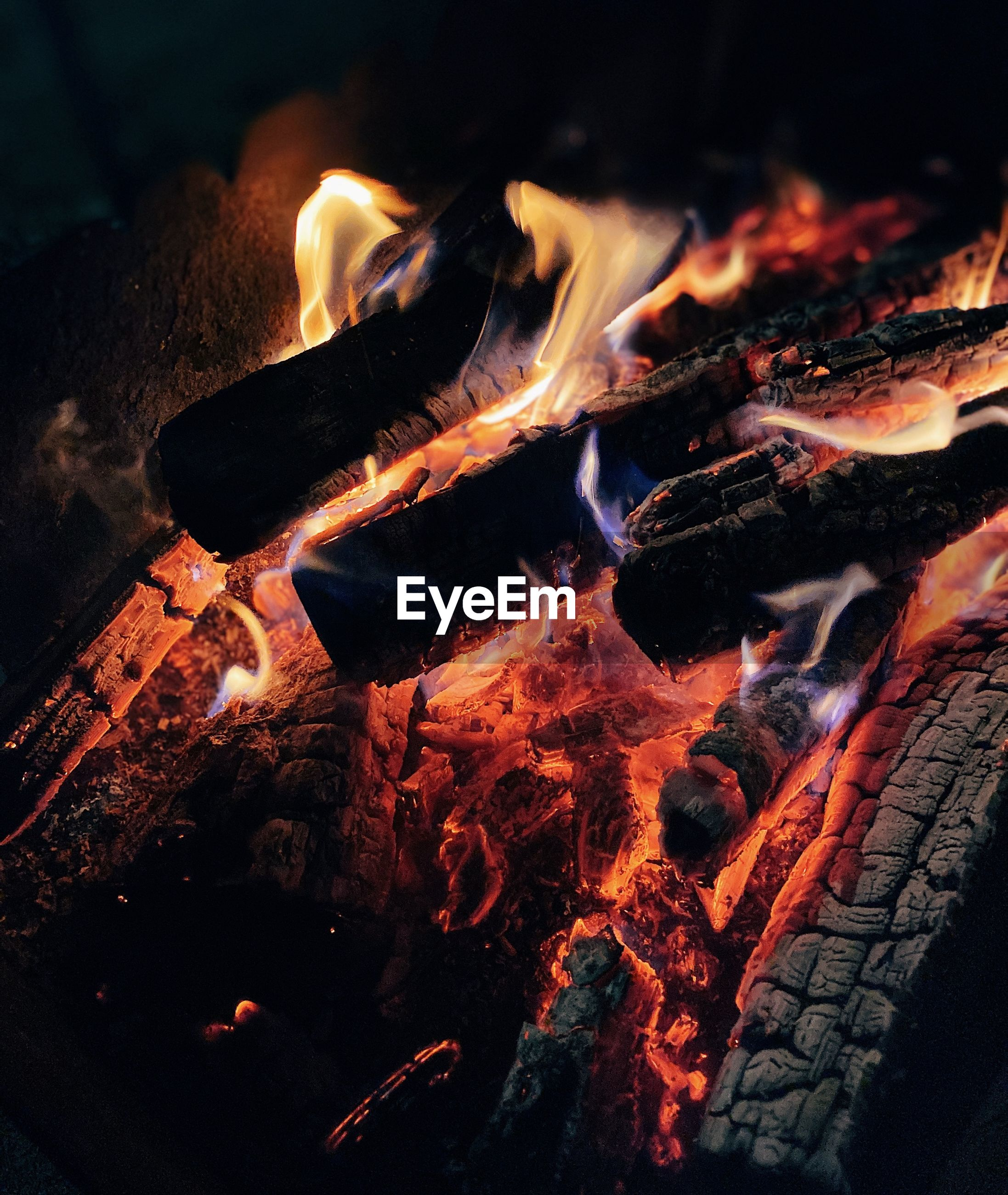 High angle view of bonfire on barbecue