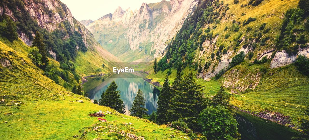 Scenic view of lake amidst mountains