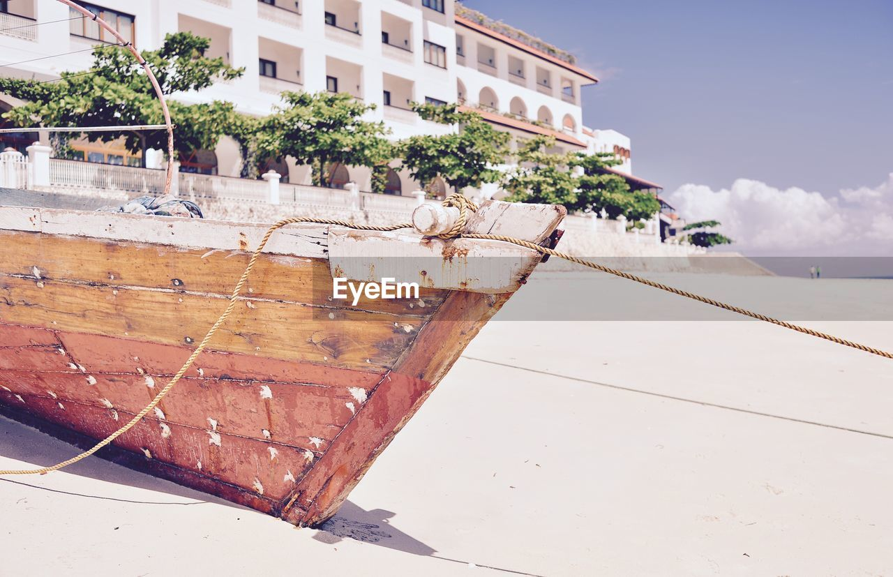water, boat, nautical vessel, sea, transportation, beach, outdoors, day, sand, sky, moored, architecture, nature, no people, tree, building exterior, beauty in nature